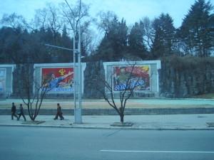 Mostly Empty Sidewalks With Giant Propaganda Murals
